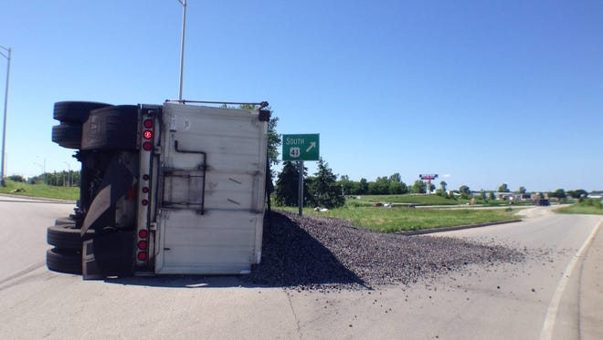 A semi-trailer overturned on U.S. 41 in Kaukauna Thursday, closing down the south on ramp and a portion of the roundabout while officials cleaned up the spill.