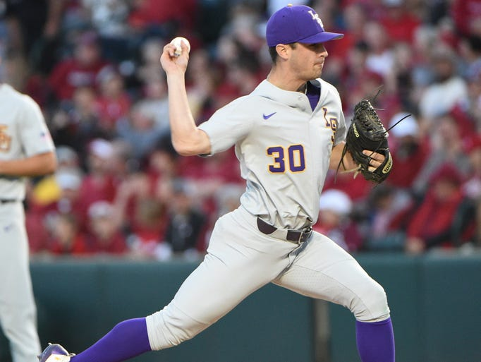 LSU's Colin Strall warms up for relief  in the second