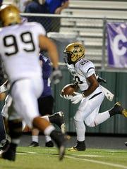 Abilene High linebacker Terrell Franklin (20) returns an interception for a touchdown in the first quarter of the Eagles' 56-31 win on Thursday, Nov. 3, 2016, at Keller Athletic Complex.
