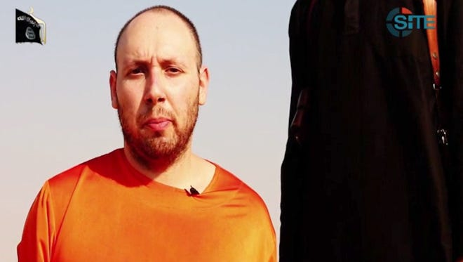 An image from a video released by the Islamic State and identified by private terrorism monitor SITE Intelligence Group  shows U.S. journalist Steven Sotloff before being beheaded by a masked militant.