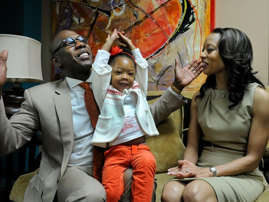Bishop Joseph Walker III sings with his daughter Jovanni Willow and wife Stephaine in the green room of Mt. Zion Baptist Church on Sunday, Jan. 11, 2015, in Nashville.