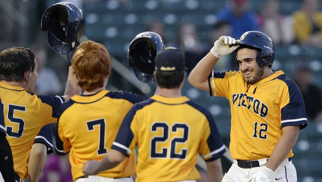 Victor's Chris Varone, right, is greeted at the plate by teammates after his two-run home run during a Class AA sectional semifinal at Frontier Field, Thursday, May 24, 2018. No. 1 seed Victor advnaced to the Class AA final with a 15-2 win over No. 5 seed Webster Schroeder.