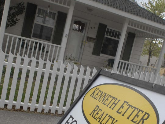 File photo: A for sale sign in front of a home on Nixon