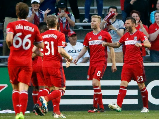 Chicago Fire forward Nemanja Nikolic, right, celebrates with teammates after scoring a goal during the first half of the team's MLS soccer match against the Colorado Rapids, Wednesday, May 17, 2017, in Bridgeview, Ill. (AP Photo/Nam Y. Huh)