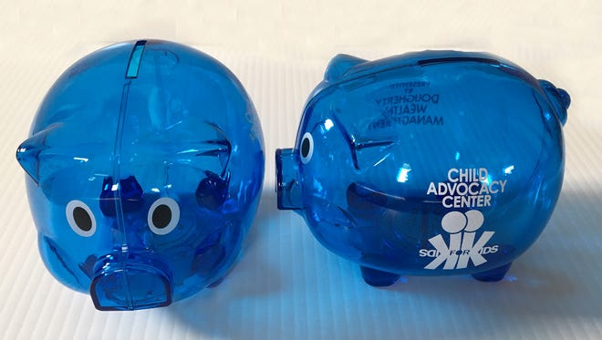 Children of all ages can pick up a blue piggy bank from CAC's administrative offices.