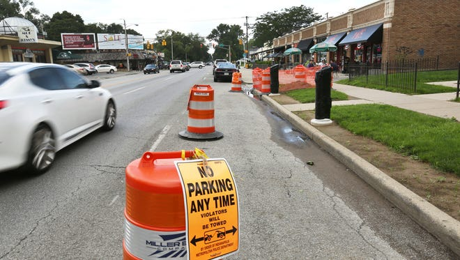 BlueIndy electric car charging stations are under construction at 54th Street and College Avenue. A franchise agreement would require public hearings on the placement of 200 charging stations.