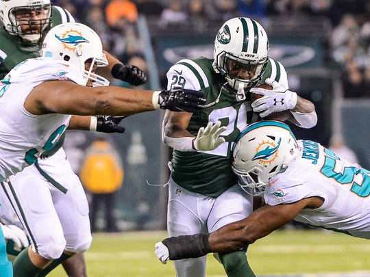 Dec 17, 2016; East Rutherford, NJ, USA; New York Jets running back Bilal Powell (29) is tackled by Miami Dolphins outside linebacker Jelani Jenkins (53) at MetLife Stadium. Mandatory Credit: Dennis Schneidler-USA TODAY Sports