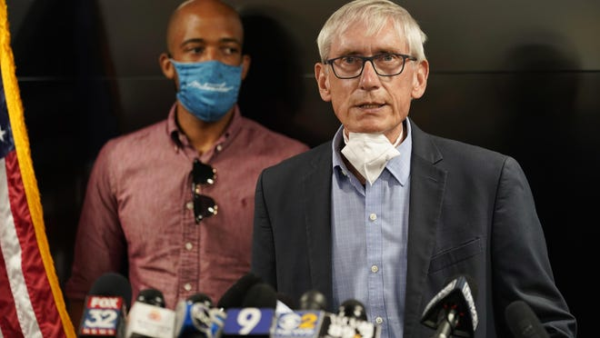 Wisconsin Gov. Tony Evers speaks during a news conference in Kenosha, Wis. Aug. 27. Wisconsin health officials and Gov. Evers announced Wednesday that they've opened a field hospital at the state fairgrounds near Milwaukee as a surge in COVID-19 cases threatens to overwhelm hospitals.