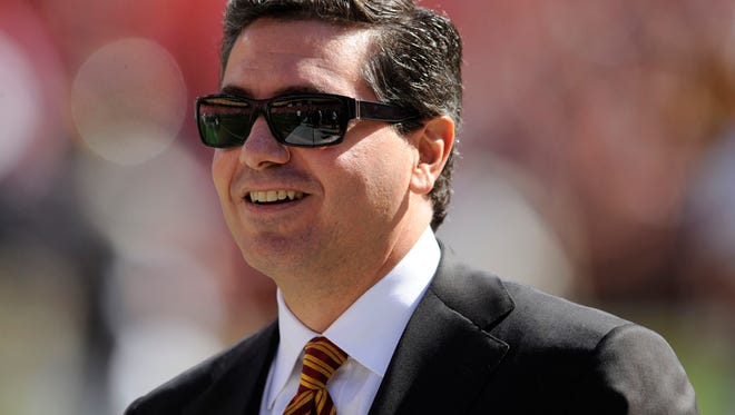 Washington Redskins owner Daniel Snyder, shown here in a file photo, told USA TODAY Sports in May 2013 that he will never change his team's mascot name, which 50 U.S. senators this week branded as racist.