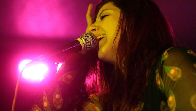 Palm Desert indie band Caxton, including singer and keyboard player Christina Reyes, performs during the second Tachevah Band Showcase at The Hood Bar and Pizza on Wednesday night in Palm Desert.