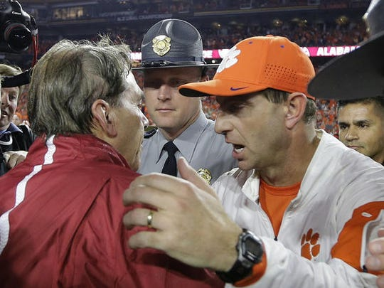 Nick Saban and Dabo Swinney after last year's national championship game. They're reunited Monday night.