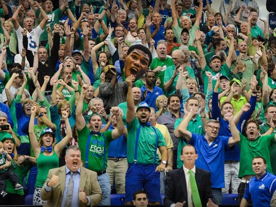 FGCU men's basketball superfan Doug Kollmer (bottom center, suspenders, right hand raised)