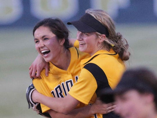 Avon High School's #28, Maddison Brock, left, is congratulated by team mate Haylie Foster, right, after making the game winning catch, during the High School Softball Regionals against the Decatur Central, Tuesday May 31st, 2016. The Avon Orioles beat the Decatur Hawks during the High School Softball Regionals, at Decatur Central.