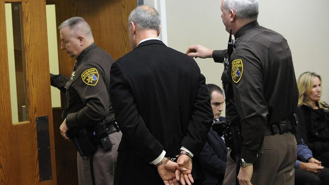 Oakland County Sheriff's Deputies escort Michael Skupin, center, out of the courtroom of Judge Kelley Kostin.