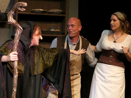 "The Baker (David Engleman) and his wife (Jordan Shocklee) come face to face with the witch (departing artistic director Cathryn Sanders) in ""Into The Woods,"" presented by the Angelo Civic Theatre in 2016."