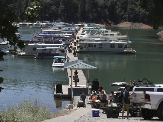 File photo - Families unload houseboats at Holiday Harbor on Lake Shasta following a busy Fourth of July weekend in 2016.