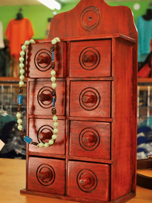 CC Boutique owner Dave Gooch hand crafts wooden items such as this jewelry box to sell in the store.