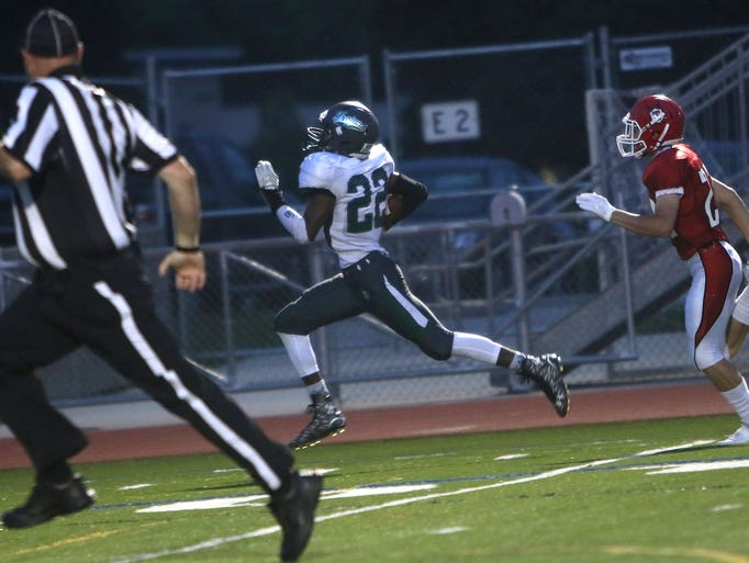 Wauwatosa West's Paris Howell runs into the end zone