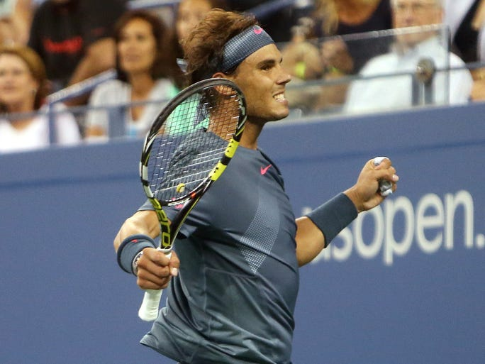 Rafael Nadal celebrates after recording match point against Tommy Robredo on day ten of the 2013 US Open at USTA Billie Jean King National Tennis Center.