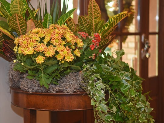 Entryways are a wonderful spot for a floral arraignment.