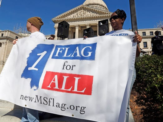 Students hold a banner calling for a new Mississippi