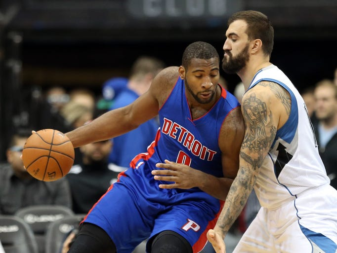 Detroit's Andre Drummond, left, drives into the block
