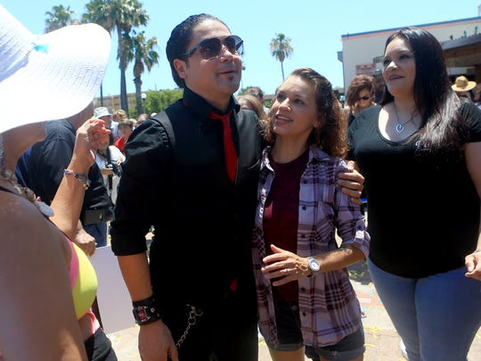 Guitarist Chris Perez meets with fans during the South Texas Music Walk of Fame on Saturday, June 3, 2017, at the Water Street Market in Corpus Christi.