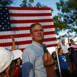 Republican presidential candidate, former Florida Gov. Jeb Bush arrives to speak at an outdoor rally before attending a high school football in Punta Gorda, Fla., Oct. 30.