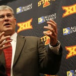 Iowa State football coach Paul Rhoads talks to the media during the national signing day news conference on Feb. 4 in the Bergstrom Football Complex. Rhoads, a 1985 graduate of Ankeny High School, was inducted into the Ankeny Alumni Association's Hall of Honor on Feb. 13.