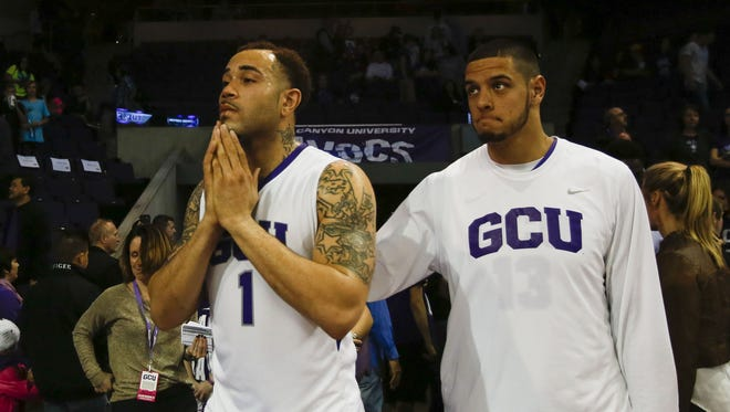 Grand Canyon University forward Grandy Glaze, left, reacts to his team's defeat as Grand Canyon University faces off against Seattle University on Saturday, Jan. 30, 2016, at Grand Canyon University Arena in Phoenix, Ariz. Seattle University defeated Grand Canyon University 59-57.