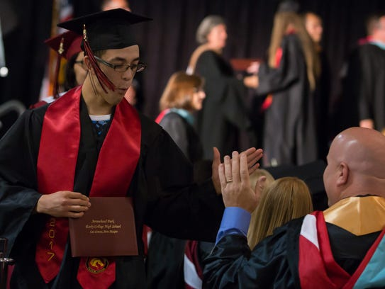 Marcos Holguin high-fives faculty member Mike Kingery
