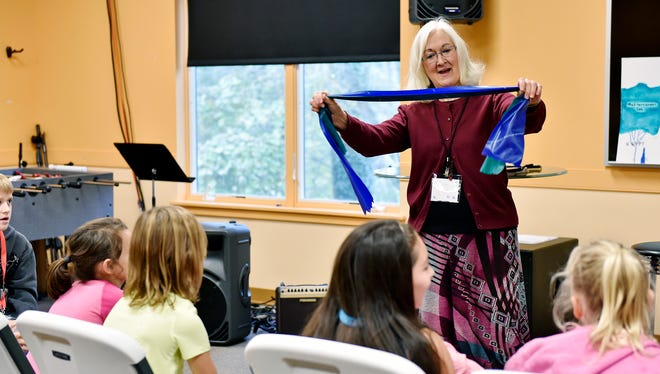 Volunteer Nancy Krape speaks to a group of Kreutz Creek Elementary School students during released time Thursday, Nov. 9, 2017, at Valley View Alliance Church in Hellam Township. Released time is time set aside during school hours for students to voluntarily receive religious education that is off-campus and receives no public funding, per a 1952 U.S. Supreme Court decision. More than a dozen Kreutz Creek Elementary third-, fourth- and fifth-grade students come for an hour of released time at Valley View Alliance Church once a week, in a program operated by Joy El Ministries.
