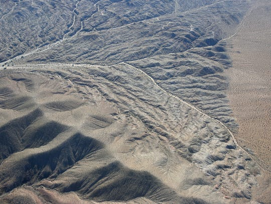 The Mojave Desert shows signs of water erosion in this