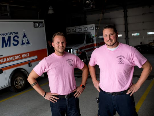 Jason Heilig, EMT, and Steven Schmidt, paramedic, show off their pink t-shirts Wednesday, Oct. 12, 2016 at Tri-Hospital EMS in Port Huron. Tri-Hospital staff members are wearing the shirts through the month of October.