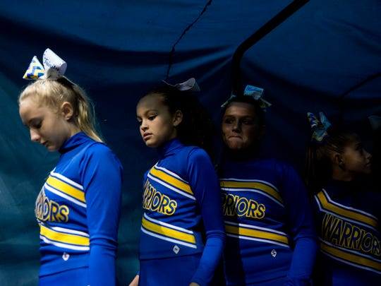 The Charlotte Warriors, from Charlotte, Fla., wait to be called for their performance during the 2016 Peace River Conference Pop Warner Cheerleading Competition at Germain Arena on Sunday, Oct. 23, 2016, in Estero, Fla.