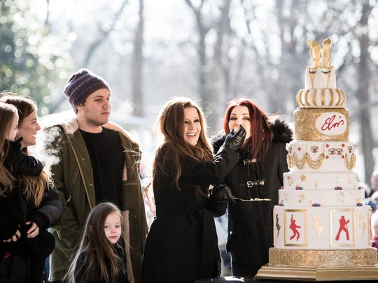 January 08, 2015 - Lisa Marie Presley's children, left, watch as she feeds a piece of birthday cake to Priscilla Presley, far right, during the 80th birthday celebration for Elvis Presley at Graceland.