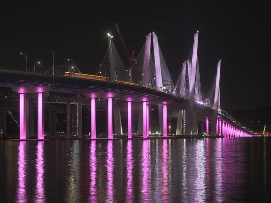 The Gov. Mario Cuomo Bridge with pink lights in honor