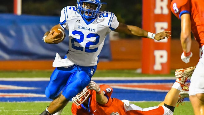 Presbyterian Christian School running back Isaiah Woullard runs away from Jackson Prep during Friday's game. Woullard had a 76-yard touchdown run on the first play of the game as the Bobcats beat the Patriots.