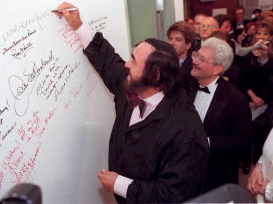 Luciano Pavarotti signs the wall at the Michigan Opera