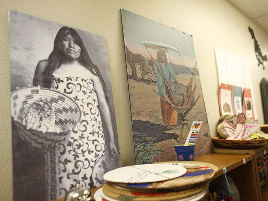 Native American artwork is displayed on the walls inside