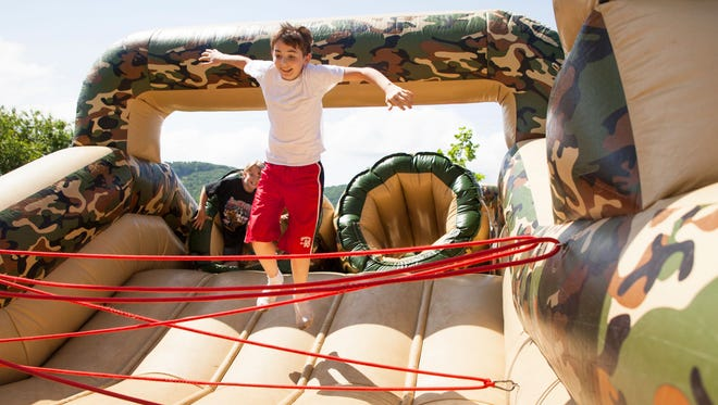 Hunter Craig speeds through an inflatable obstacle course at XtremeFest in Waynesboro.