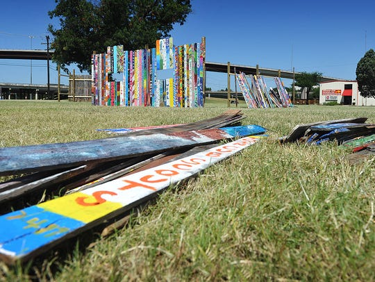 About half of the more than 1,100 painted pickets had