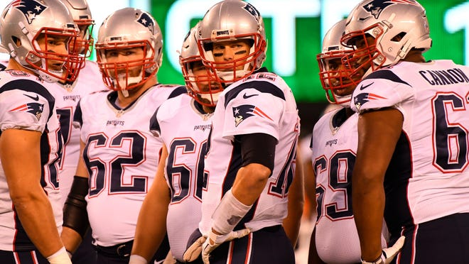 Nov 27, 2016; East Rutherford, NJ, USA; New England Patriots quarterback Tom Brady (12) and teammates look on during the first half against the New York Jets at MetLife Stadium. Mandatory Credit: Robert Deutsch-USA TODAY Sports