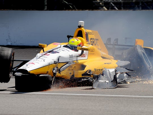 IndyCar driver Spencer Pigot hits the wall coming out of turn one during practice for the 100th running of the Indianapolis 500 Wednesday, May 18, 2016, afternoon at the Indianapolis Motor Speedway.