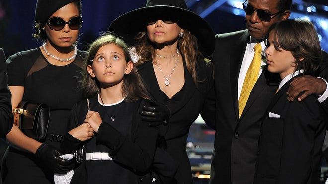 In this July 7, 2009 file photo, the Jackson family, from left, Janet Jackson, Paris Jackson, LaToya Jackson, Jackie Jackson and Prince Michael appear on stage at the memorial service for music legend Michael Jackson, at the Staples Center in Los Angeles. Michael Jackson died on June 25, 2009.