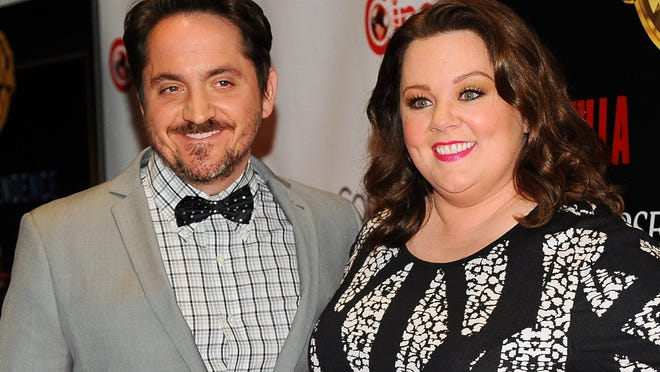 "This March 27 photo shows actress Melissa McCarthy, right, a cast member, co-writer and producer of the upcoming film ""Tammy,"" and her husband Ben Falcone, co-writer/director of the film, before the Warner Bros. presentation at CinemaCon 2014 in Las Vegas. The couple star in the comedy ""Tammy."""