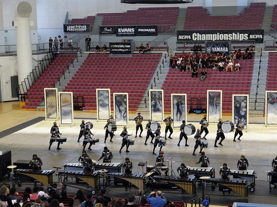"The Adolfo Camarillo High School Winter Drumline Ensemble performs ""Into the Light"" on Sunday at CSU San Bernardino."