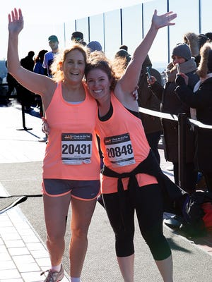 South Brunswick resident Beth Slansky with her trainer, Rebecca Lehrman, after crossing the finish line of the National MS Society's MS Climb to the Top NYC event last year.