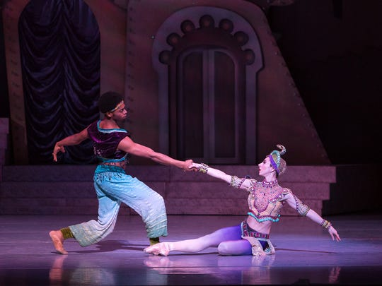 "The Snake Lady and Snake Charmer in Nashville Ballet's 10th anniversary production of ""Nashville's Nutcracker."""