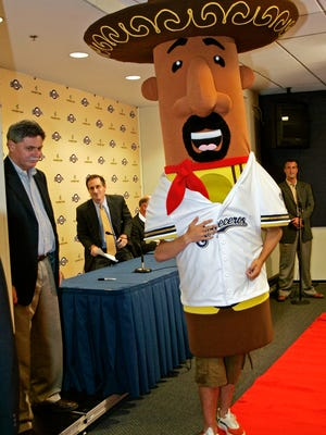 The Milwaukee Brewers' newest racing sausage, Chorizo, is introduced at a news conference July 27, 2006, at Miller Park in Milwaukee. The sausages race every home game in the top of the seventh inning. At left are Brewers' general manager Doug Melvin and executive vice president Rick Schlesinger, center.